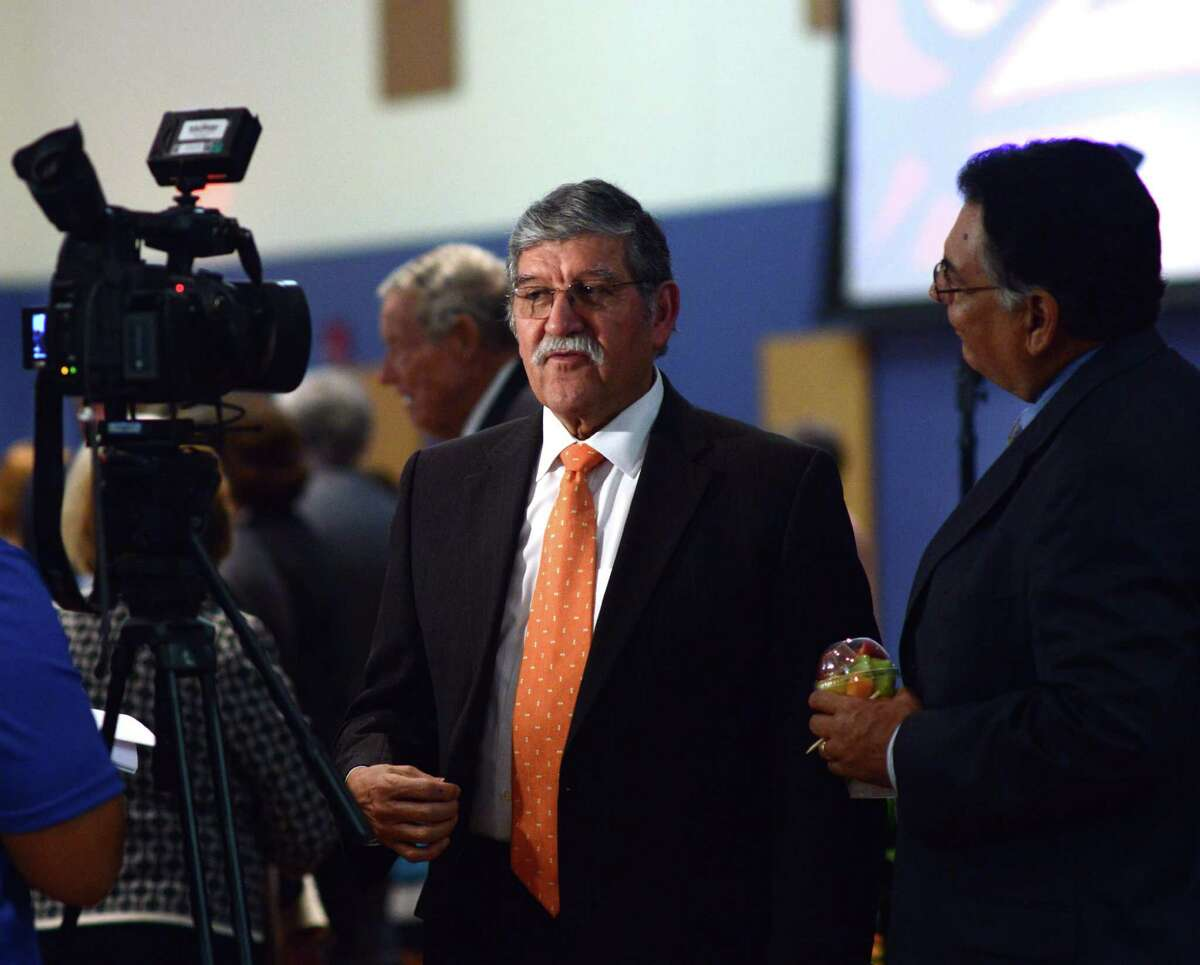 UTSA President Dr. Ricardo Romo mingles after his State of the University address on Tuesday, Sept. 30, 2014.