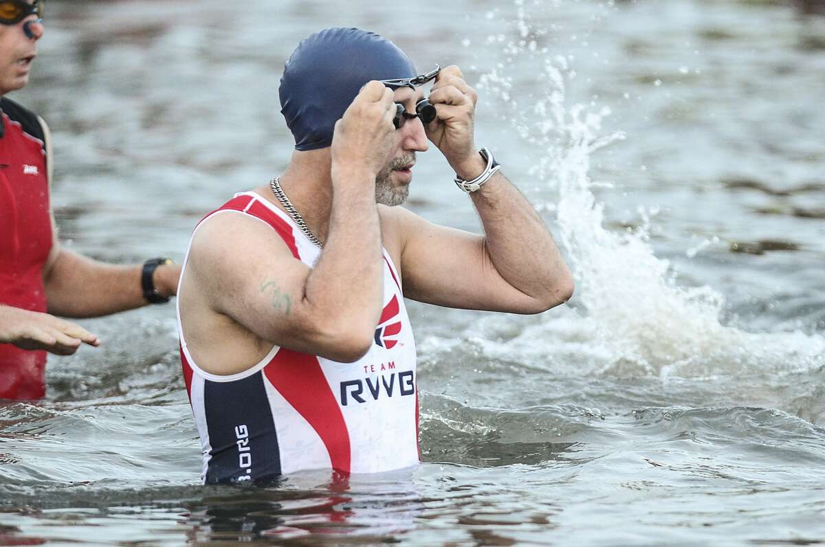 Katy resident David Thurman of Team RWB gets gets ready in the water for the swimming portion of the Katy Triathlon at Firethorne.