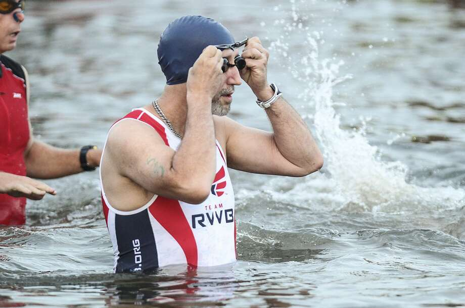 Katy resident David Thurman of Team RWB gets gets ready in the water for the swimming portion of the Katy Triathlon at Firethorne. Photo: Diana L. Porter, Freelance / © Diana L. Porter