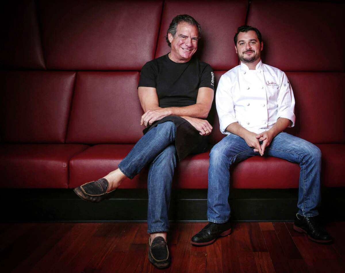 (l-r) Michael Cordéºa Restaurateur/ Founder and Chairman of the Board é± Cordéºa with his son David Cordéºa Executive Chef of Development - Cordéºa Restaurants Tuesday Sept, 30, 2014 at Churrascos Champions at 7877 Willow Chase Blvd in Houston TX, Sept 30, 2014. Cordua Restaurants has opened its fifth Houston-area location in the Champions area. The new Churrascos will seat approximately 200, plus 50 on a covered patio. What makes this location important is that it is a prototype for future restaurants as the Corduas look to expand out of Texas. This will be the ninth Cordéºa restaurant in the Greater Houston area and the fourth to open since 2010. (Billy Smith II / Chronicle)