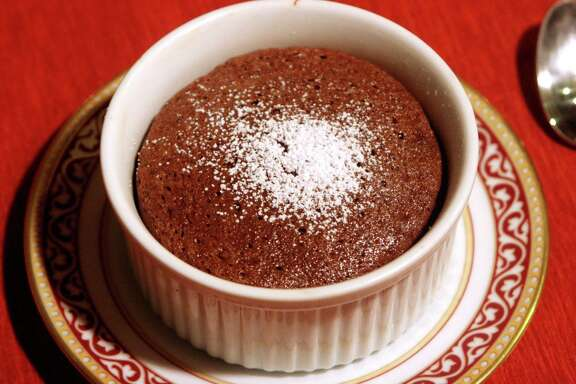 **FOR USE WITH AP LIFESTYLES** A mini-chocolate souffle is seen in this Saturday, Jan. 19, 2008 photo in New York.  This feathery chocolate dessert will make your Valentine melt.    (AP Photo/Howie Rumberg)