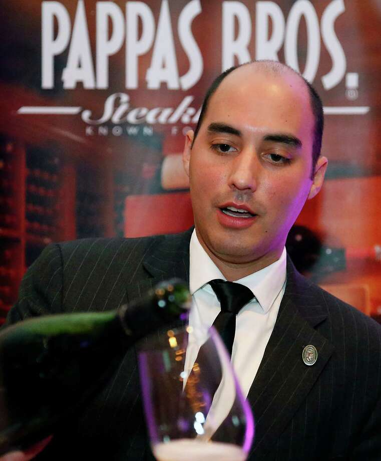 "Pappas Bros. Steakhouse sommelier Steven McDonald pours a glass of wine during the Periwinkle Foundation's ""Iron Sommelier"" annual wine tasting and sommelier competition at the Houstonian Hotel Thursday, Oct. 2, 2014, in Houston. McDonald was named the 2014 Iron Sommelier. ( James Nielsen / Houston Chronicle ) Photo: James Nielsen, Staff / © 2014  Houston Chronicle"