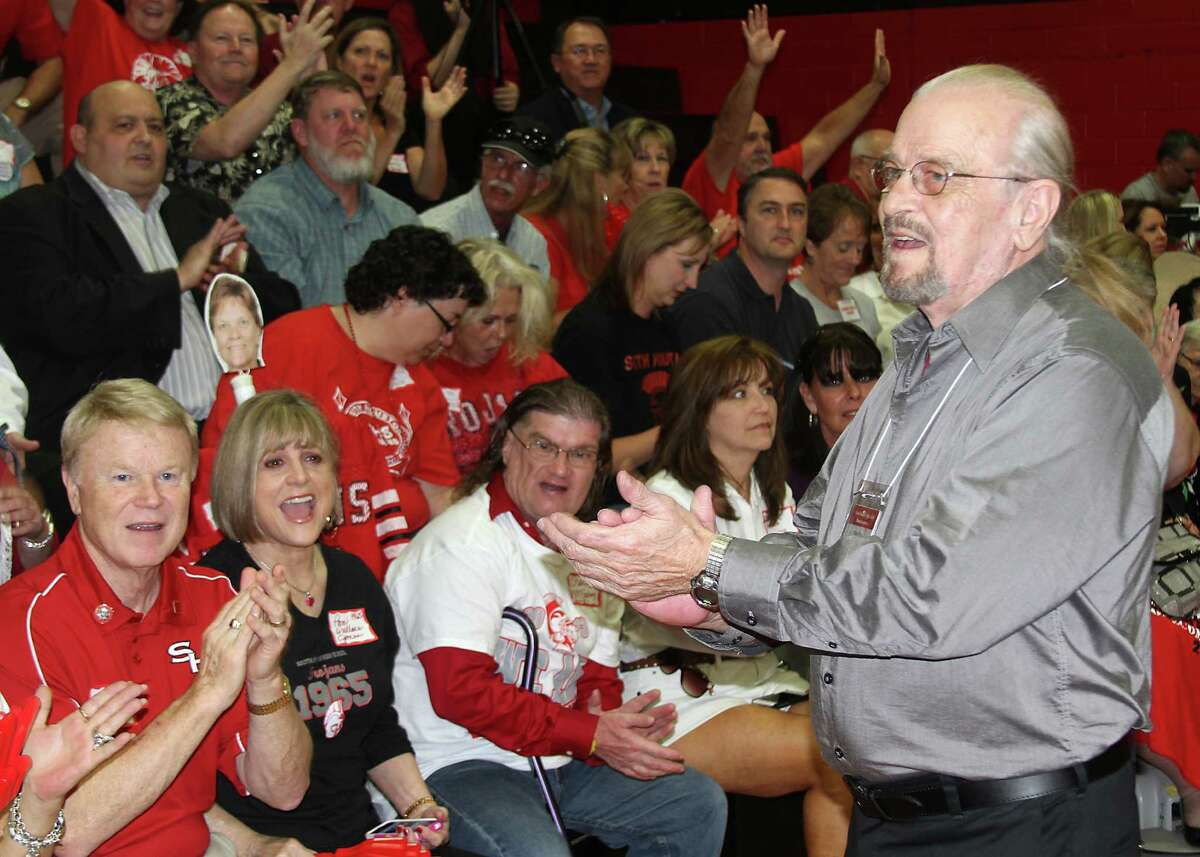 """Bob Fay of South Houston High's first graduating class in 1959 and the first """"Hector"""" mascot leads cheers at the 2013 pep rally."""