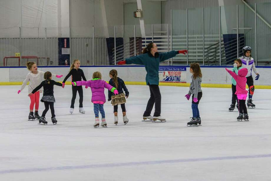 Jeannie Foland, a skating instructor at the Space City Skating Rink, 18150 Gulf Freeway, gets out on the ice with her students. The rink is set to close Oct. 10, leaving skaters to find a new place to practice. Photo: ÂKim Christensen, Photographer / ©Kim Christensen