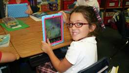 "Second-grader Jordan Roberts is among pupils using iPads at River Oaks Baptist School. ""We really want to support children learning through hands-on learning, allowing kids to be more creative,"" says Maria Franshaw, the lower school head at the campus."