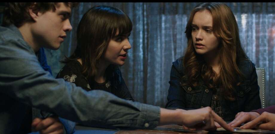 "Douglas Smith, Ana Coto and Olivia Cooke star in the low-budget horror film ""Ouija."" Photo: Universal Pictures / Universal Pictures / ONLINE_YES"