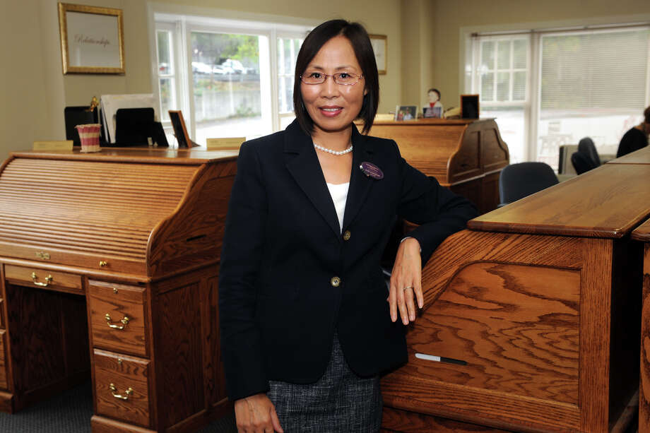 Realtor Guihue (Ginger) Zhu at Berkshire Hathaway Home Services, in Westport, Conn. Oct. 7,2014. Photo: Ned Gerard / Connecticut Post