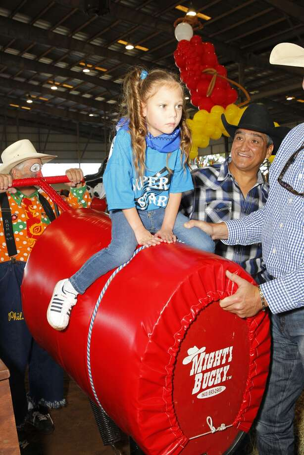 Five-year-old Destiny Avalos tries out the mechanical bull at the Fort Bend County Fair Association's second annual Exceptional Rodeo.  Five-year-old Destiny Avalos tries out the mechanical bull at the Fort Bend County Fair Association's second annual Exceptional Rodeo. Photo: Diana L. Porter, Freelance / © Diana L. Porter