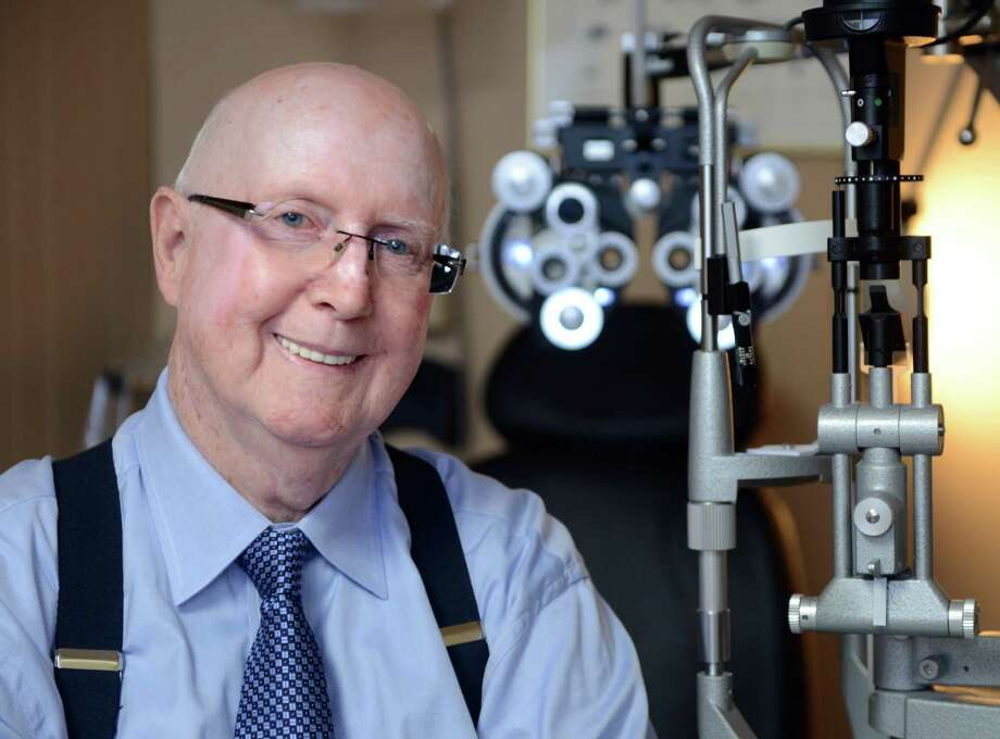 Dr. Michael Gorman, optician and owner of Family Vision Center, sits in an exam room at the practice's Stratford location. Photo: Autumn Driscoll / Connecticut Post