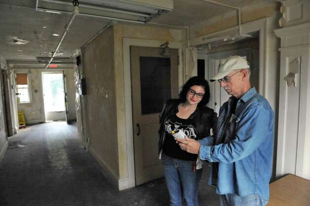Shaker Heritage Society education director Samantha Saladino, left, and paranormal investigator Tom Conwell check Mel Meter readings in the Shaker Bretheren's workshop Saturday Oct. 4, 2014, in Colonie, NY.  (John Carl D'Annibale / Times Union) Photo: John Carl D'Annibale / 10028895A