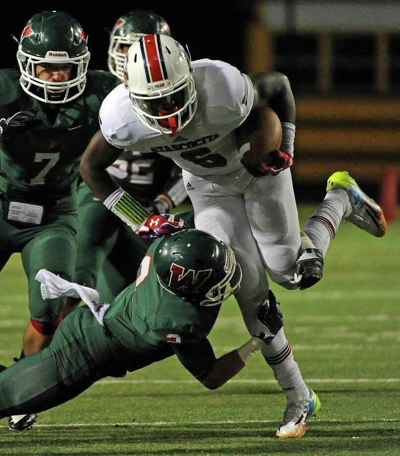 Atascocita running back Patrick Taylor, Jr., right, breaks the tackle of Woodlands defensive back TC Schneider during the second half of a high school football game, Saturday, October 4, 2014, at Woodforest Stadium in Shenandoah, TX. (Photo: Eric Christian Smith/For the Chronicle) Photo: Eric Christian Smith, Freelance / 2014 Eric Christian Smith