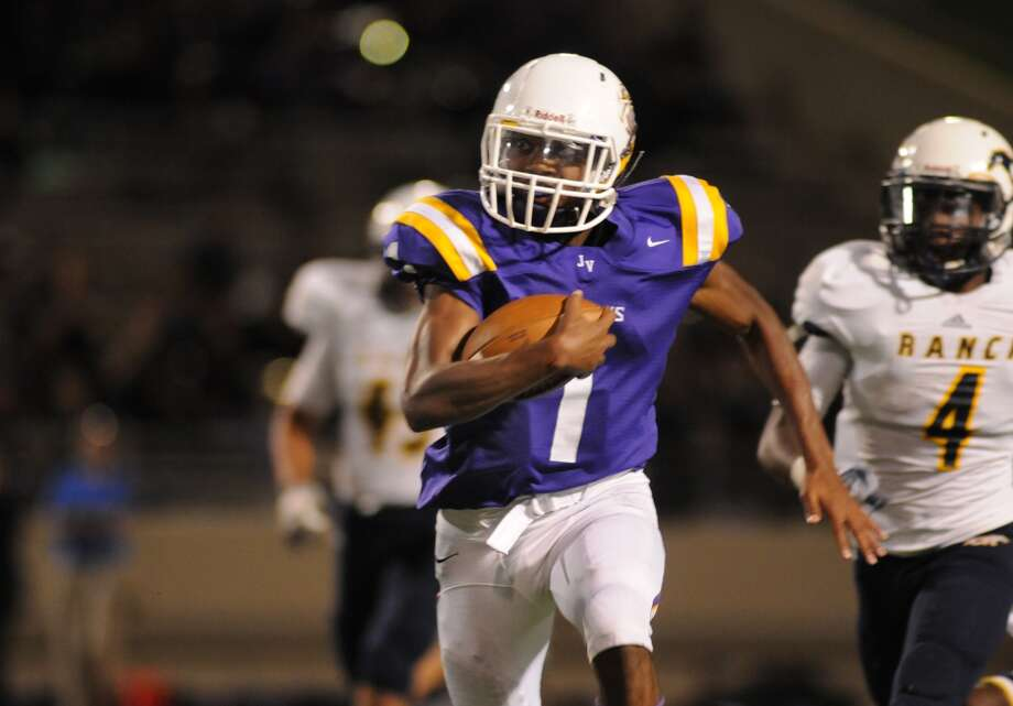 Jersey Village junior quarterback Deshun Qualls broke away from the Cy Ranch defense repeatedly at Pridgeon Stadium last week. Photo: Jerry Baker, Freelance