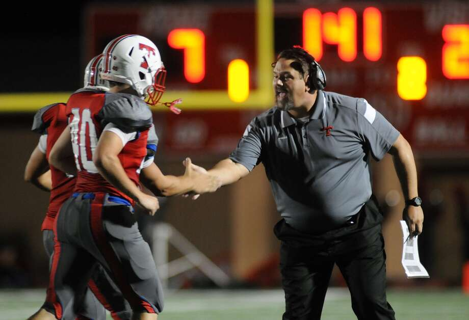 Tomball head coach Danny Ramsey, right, celebrated a Cougar touchdown against Stratford last week. Photo: Jerry Baker, Freelance