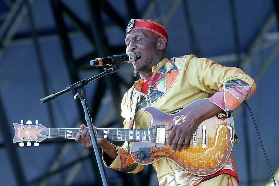 Jimmy Cliff: Dressed in a colorful (and colorfully decorated) gold outfit and sporting casual red shoes, Cliff remains the singing, guitar-playing, songwriting and dancing machine that the Rolling Stones and the world fell in love with decades ago. Photo: Gary Miller, FilmMagic / 2014 Gary Miller