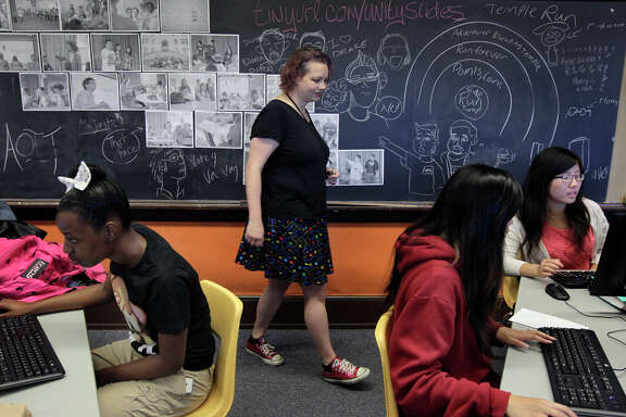 Angie Hoffman helps students create video games in a class at Balboa High School. Zynga pays her salary and also bought half the computers.