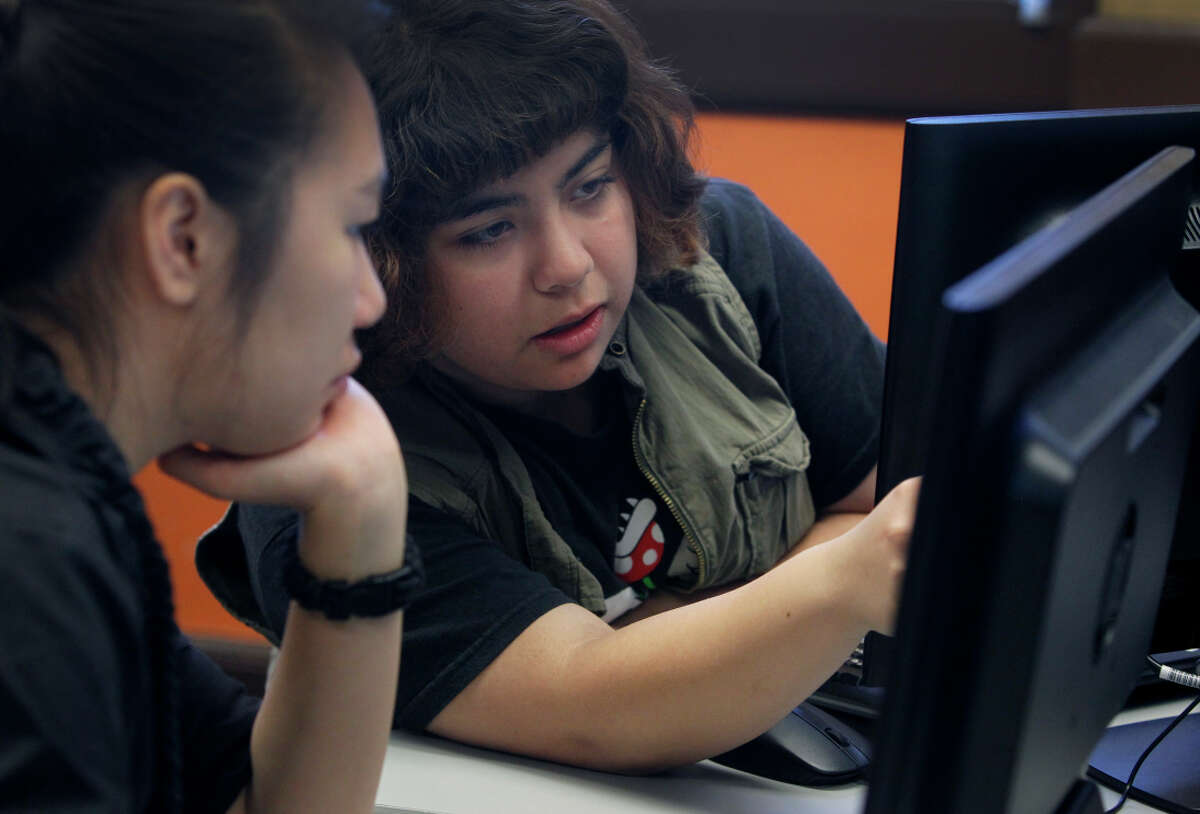 Lien Huang (left) and AM Echeverria discuss their projects. Besides Balboa, the video game design class is also offered at Thurgood Marshall High School.