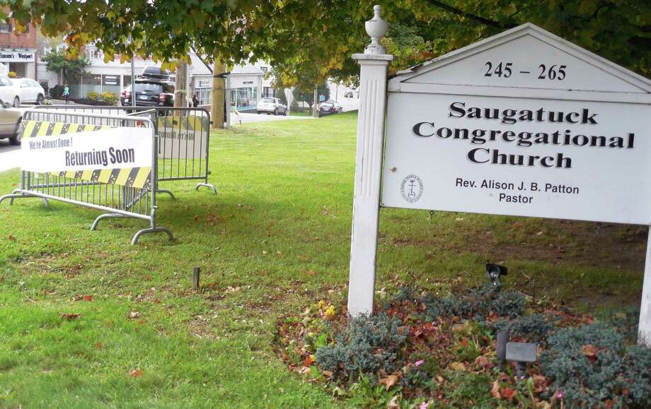 """There are two signs on the front lawn of the Saugatuck Congregational Church announcing that reconstruction of the fire-damaged, historic Post Road East church is """"almost done."""" Photo: Anne M. Amato / westport news"""