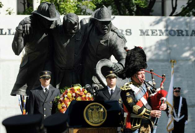 Joe Brady, regimental pipe major, right, performs during the New York State Fallen Firefighters Memorial Ceremony on Tuesday, Oct. 7, 2014, at the Empire State Plaza in Albany, N.Y. (Cindy Schultz / Times Union) Photo: Cindy Schultz / 00028598A