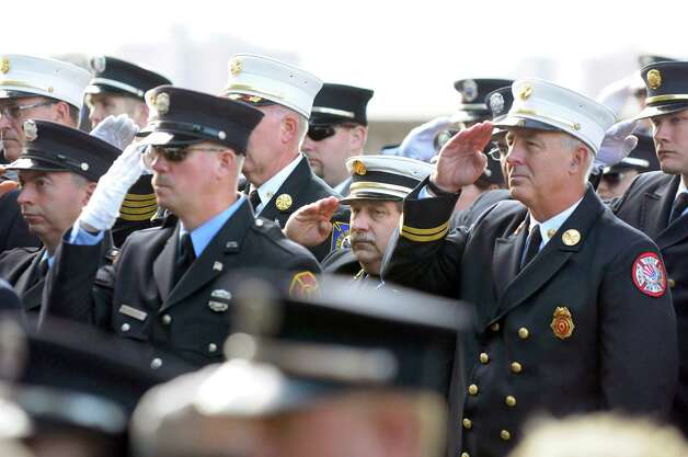 City of Troy firefighters salute as the National Anthem plays during the New York State Fallen Firefighters Memorial Ceremony on Tuesday, Oct. 7, 2014, at the Empire State Plaza in Albany, N.Y. (Cindy Schultz / Times Union) Photo: Cindy Schultz / 00028598A