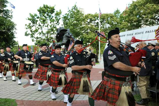 The Westchester Firefighters Emerald Society Pipes and Drums process at the start of the New York State Fallen Firefighters Memorial Ceremony on Tuesday, Oct. 7, 2014, at the Empire State Plaza in Albany, N.Y. (Cindy Schultz / Times Union) Photo: Cindy Schultz / 00028598A