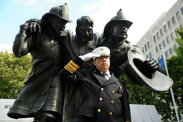 Francis Nerney Jr., deputy state fire administrator at the Office of Fire Prevention and Control, salutes at the start of the New York State Fallen Firefighters Memorial Ceremony on Tuesday, Oct. 7, 2014, at the Empire State Plaza in Albany, N.Y. (Cindy Schultz / Times Union) Photo: Cindy Schultz / 00028598A