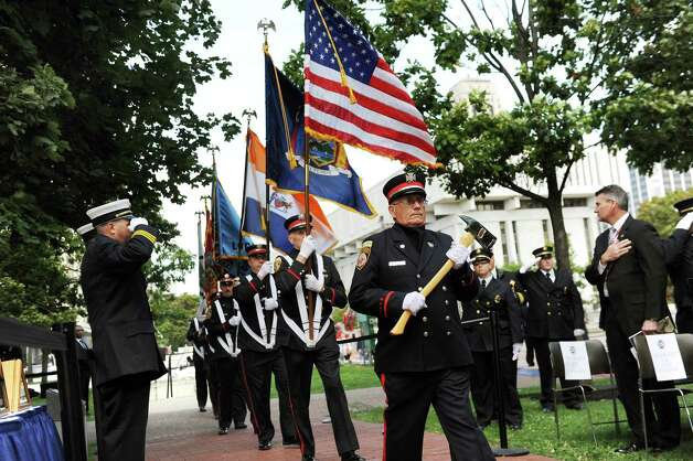Albany Fire Department Color Guard process at the start of the New York State Fallen Firefighters Memorial Ceremony on Tuesday, Oct. 7, 2014, at the Empire State Plaza in Albany, N.Y. (Cindy Schultz / Times Union) Photo: Cindy Schultz / 00028598A