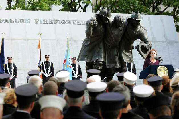 Mary Kavaney, assistant deputy secretary for Public Safety, right, speaks during the New York State Fallen Firefighters Memorial Ceremony on Tuesday, Oct. 7, 2014, at the Empire State Plaza in Albany, N.Y. (Cindy Schultz / Times Union) Photo: Cindy Schultz / 00028598A
