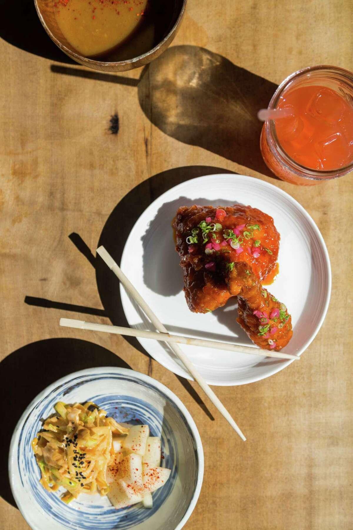 Korean fried chicken with spicy slaw, pickled daikon and dash gravy at Namu Gaji in San Francisco.