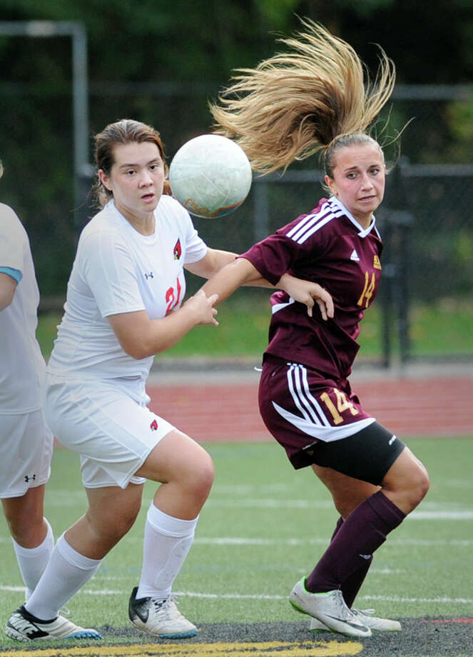 At left, Jamie Kockenmeister (#21) of Greenwich High School goes for a loose ball along with Marissa Grasso (#14) of St. Joseph High School during the girls high school soccer match between Greenwich High School and St. Joseph High School at Greenwich, Tuesday, Oct. 7, 2014. St. Joe's won the match over Greenwich by a score of 2-0 to remain undefeated. Photo: Bob Luckey / Greenwich Time