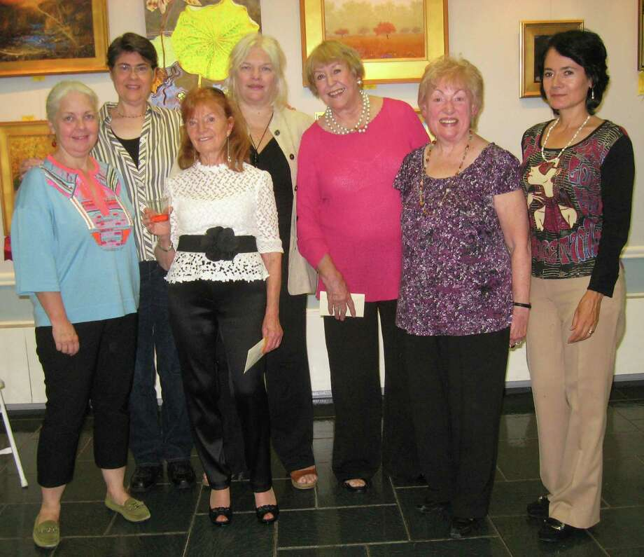 Artists recognized recently by the Art Society of Old Greenwich for their creative vision in the group's 2014 Art show, which is on exhibit at the Garden Education Center through Oct. 30, above from left, are  Susan McHale, first place for sculpture; Carol Zahn, second place for photography; Lucie Anderes, first place for oil; Carolyn Lyngholm, first place for photography; Nancy Kulinski, first place for watercolor; Grace LeVander, second place for watercolor; and Rosa Colon, second place for mixed media.  Winners not shown are  Elizabeth Agresta, second place for oils, and first place for acrylic; Mary Ann Gadziala, third place for oil; Alice Parker, third place for photography; Patrick Antonelle, second place for acrylic; James Ryan, third place for acrylic; Frank Smurlo, honorable mention for acrylic, Wynn Jackson, first place for pastel/drawing; and Carol Nipomnich Dixon, first place for mixed media. Photo: Contributed Photo / Greenwich Time Contributed