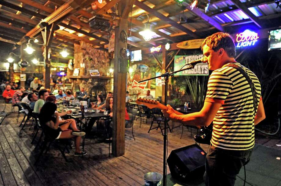 David Isely, right, takes the stage during open mic at Musician's Night held every Tuesday at Starvin Marvin's in Beaumont on Tuesday, June 25, 2013. Photo taken: Randy Edwards/The Enterprise Photo: Randy Edwards