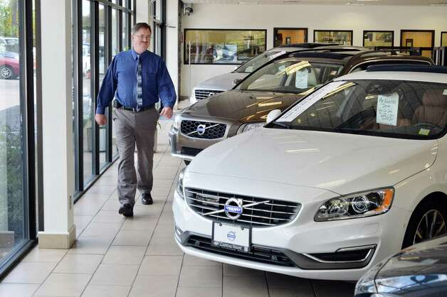 Salesman Jonathan Kirschman in the Capital Volvo of Albany showroom Tuesday Oct. 7, 2014, in Albany, NY.  (John Carl D'Annibale / Times Union) Photo: John Carl D'Annibale / 10028918A