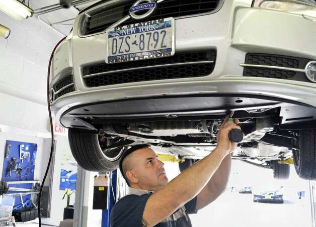 Volvo certified technician Sam DeSarno works on a car in the service department at Capital Volvo of Albany Tuesday Oct. 7, 2014, in Albany, NY.  (John Carl D'Annibale / Times Union) Photo: John Carl D'Annibale / 10028918A