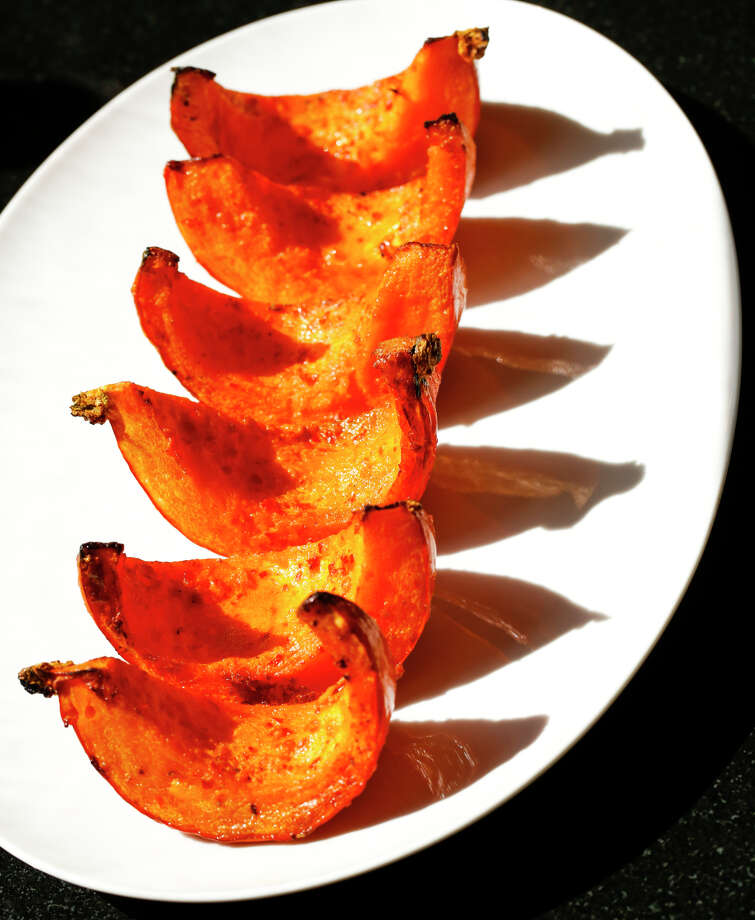 Sambal Roasted Pumpkin uses chile-garlic paste to add a little oomph to simple roasted pumpkin. Photo: Russell Yip / The Chronicle / ONLINE_YES