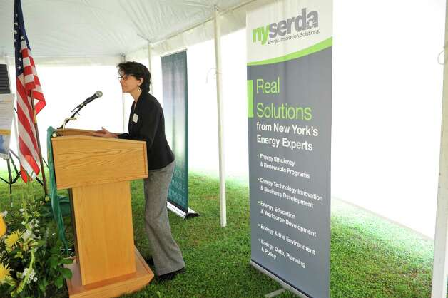 Janet Joseph, vice president for technology and strategic planning for NYSERDA, addresses those gathered during an event to unveil Skidmore College's large solar electric project on Tuesday, Oct. 7, 2014, in Greenfield Center, N.Y. The solar project consists of 6,950 ground-mounted solar panels over eight acres. The panels will generate 2.6 million kilowatt hours of electricity annually.  (Paul Buckowski / Times Union) Photo: Paul Buckowski / 00028888A