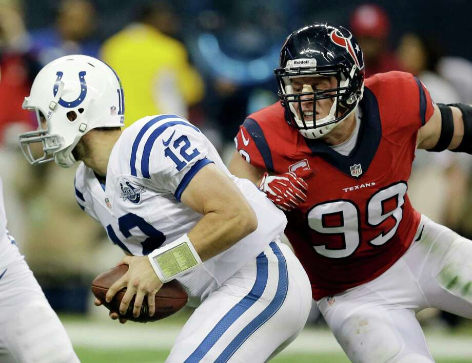 FILE - In this Nov. 3, 2013, file photo, Indianapolis Colts' Andrew Luck (12) is pressured by Houston Texans' J.J. Watt during the second quarter of an NFL football game  in Houston. The Colts' offensive line has one major challenge against Houston on Thursday night, Oct. 9, 2014, protect franchise quarterback Andrew Luck. There's only way to do that _ blocking J.J. Watt.  (AP Photo/David J. Phillip, File) Photo: David J. Phillip, Associated Press / AP