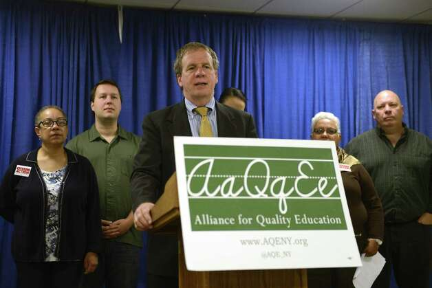 "Billy Easton, executive director of the Alliance for Quality Education, releases a report on senate funding of upstate schools Tuesday morning, Oct. 7, 2014, during a press conference at the Legislative Office Building in Albany, N.Y. The report compiled an analysis for Senate Districts north of New York City, showing school funding delivered by senators in 2014. AQE claims that senate Republicans are unfairly accusing Democratic candidates of ""underfunding"" upstate schools. (Will Waldron/Times Union) Photo: WW / 10028927A"