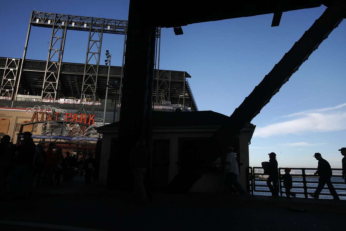 People pour over the 3rd street bridge towards the stadium before Game 4 of the National League Division Series Oct. 7, 2014 at AT&T Park in San Francisco, Calif.