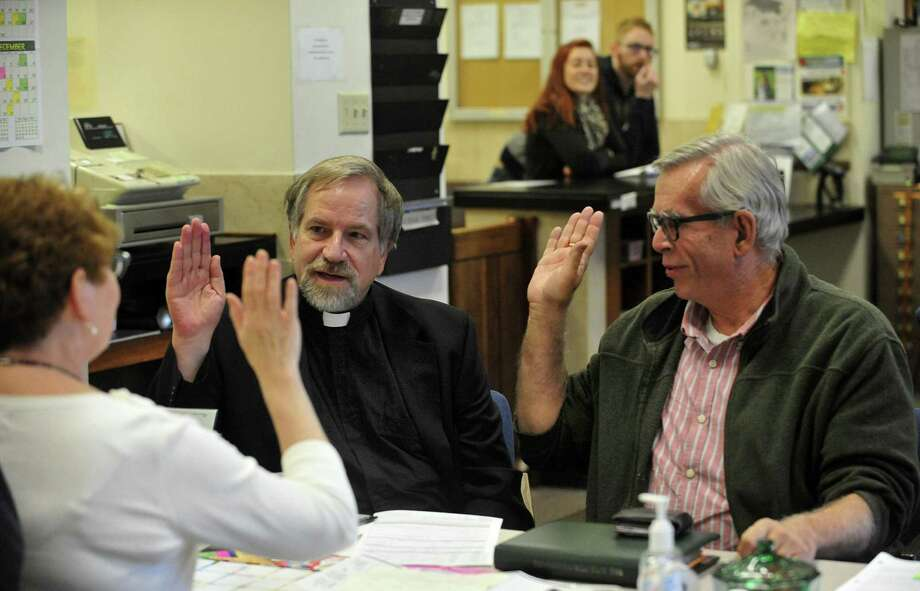 Tony Larsen, 65  (left), and partner Craig Matheus, 62, verify their vital information with deputy clerk Joanne Smith  as they apply for a marriage license in the county clerk's office  in Racine, Wis. Photo: Scott Anderson / Associated Press / The Journal Times