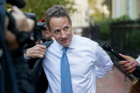 Timothy Geithner, president and managing director of Warburg Pincus and former U.S. Treasury secretary, negotiates a news media gantlet Tuesday on his way to testify at the U.S. Court of Federal Claims in Washington, D.C.