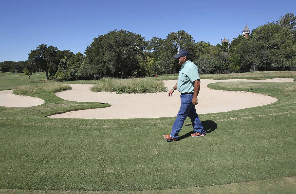 Ken Wilson, assistant director of New Braunfels Parks & Recreation, inspects the recently completed 16th green at Landa Park Golf Course, which is open after year-long renovations.