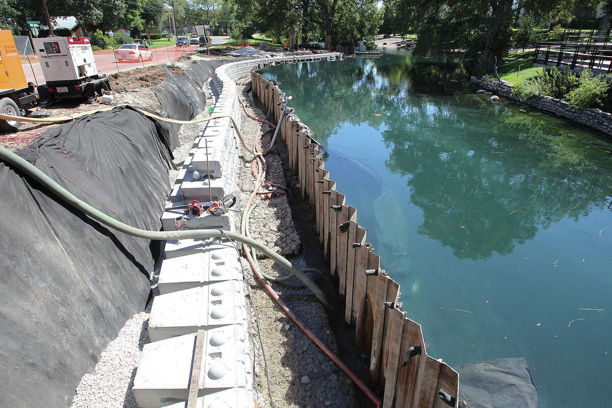 A temporary metal wall facilitates construction of retaining walls on the Comal River in Landa Park which is in its mid stages while the Landa park Golf Course renovation is finishing up on October 3, 2014.