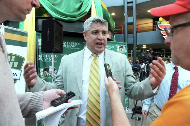 """Head coach Jimmy Patsos is interviewed during the Siena men's and women's basketball programs annual """"Sneak Preview"""" event in the atrium outside Times Union Center on Tuesday Oct. 7, 2014 in Albany, N.Y.  (Michael P. Farrell/Times Union) Photo: Michael P. Farrell / 10028924A"""