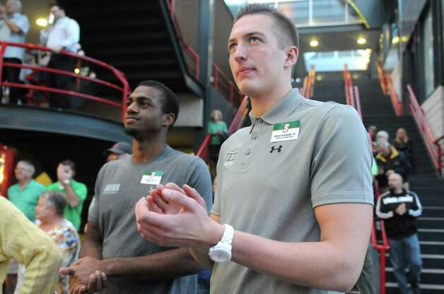 """Freshman players Jimmy Paige, left, and Willem Brandwijk where on hand for the Siena men's and women's basketball programs annual """"Sneak Preview"""" event in the atrium outside Times Union Center on Tuesday Oct. 7, 2014 in Albany, N.Y.  (Michael P. Farrell/Times Union) Photo: Michael P. Farrell / 10028924A"""