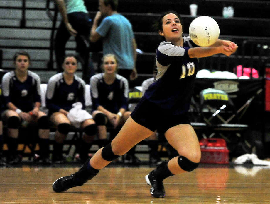 Port Neches-Groves' Jasmine Figeroa dives to keep the ball alive during Tuesday's match against Vidor. Photo taken Tuesday, October 7, 2014 Kim Brent/@kimbpix Photo: KIM BRENT / Beaumont Enterprise