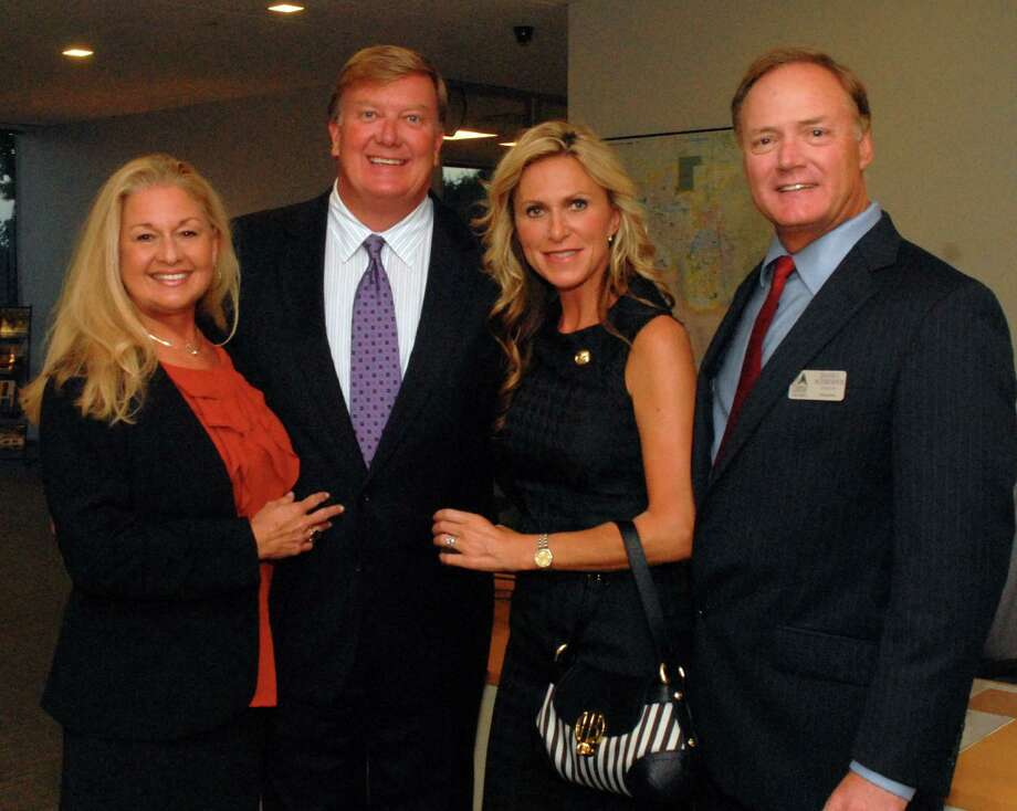 Paige and Michael Knudsen, Tammy and Daniel Schroder, Chamber Chairman of the Board, visit during The Woodlands Area Chamber of Commerce Grand Opening of their new office at 9320 Lakeside Boulevard  in The Woodlands. Photo: David Hopper, Freelance / freelance