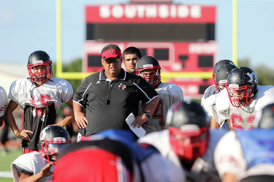 Southside head coach Ricky Lock watches the team work on kicking drills during a practice session at the school on Monday, Oct. 6, 2014.  The Cardinals are 5-0 for the first time and play Somerset in a key District 29-5A showdown on Friday.  MARVIN PFEIFFER/ mpfeiffer@express-news.net Photo: Marvin Pfeiffer/ Express-News / Express-News 2014