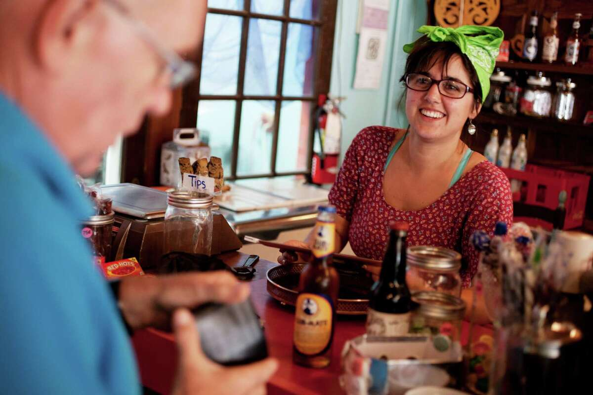 The Fizzary soda shop employee Elayna Gross rings up customer Ted Kahan at the business's mission location in San Francisco, Calif., October 7, 2014. The American Beverage Association has poured $7.7 million into the campaign to defeat the soda tax on San Francisco's November ballot.