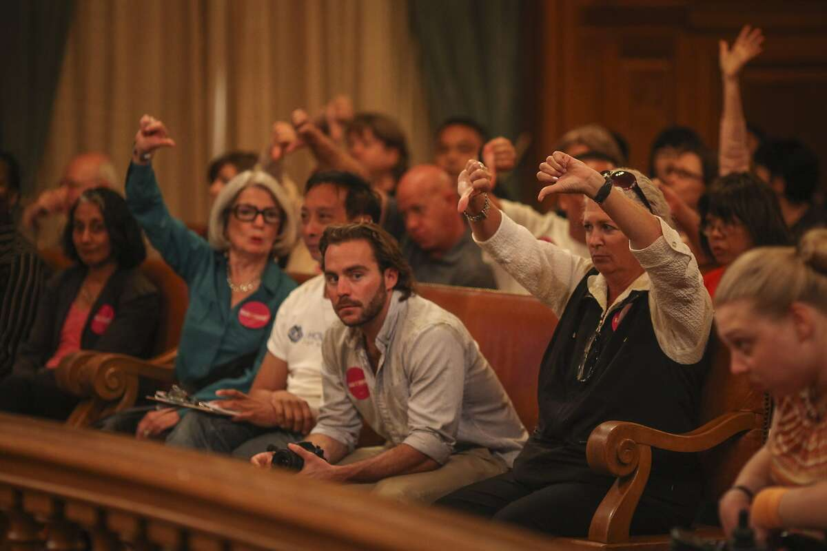 Pro house sharing members of the public react to proposed amendments during a Board of Supervisors meeting which discussed David Chiu's proposed legislation to regulate Airbnb and other short-term rentals in San Francisco on October 7th 2014.