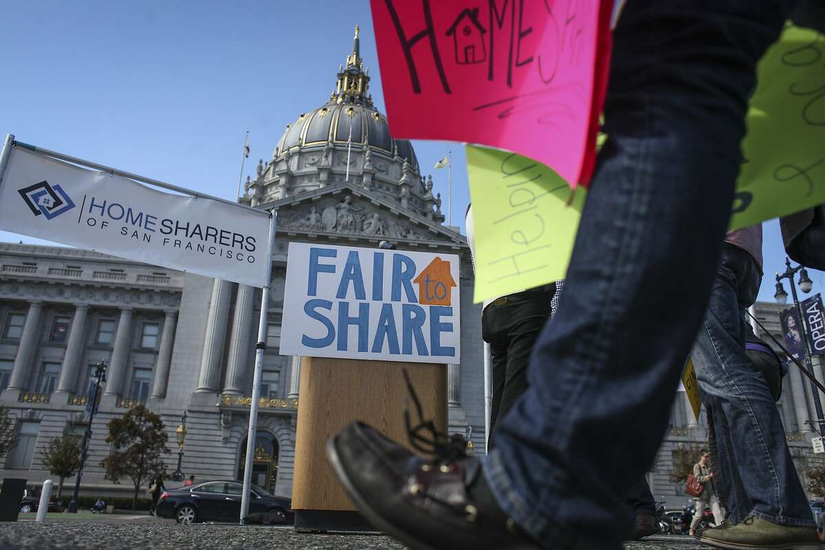 Posters at a rally held by Home Share SF, at Civic Center Plaza in San Francisco in October 2014.